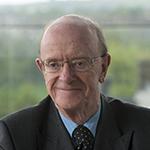 Professor Russel Griggs smiling at camera